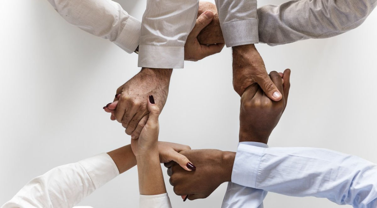 Diverse group of people holding hands