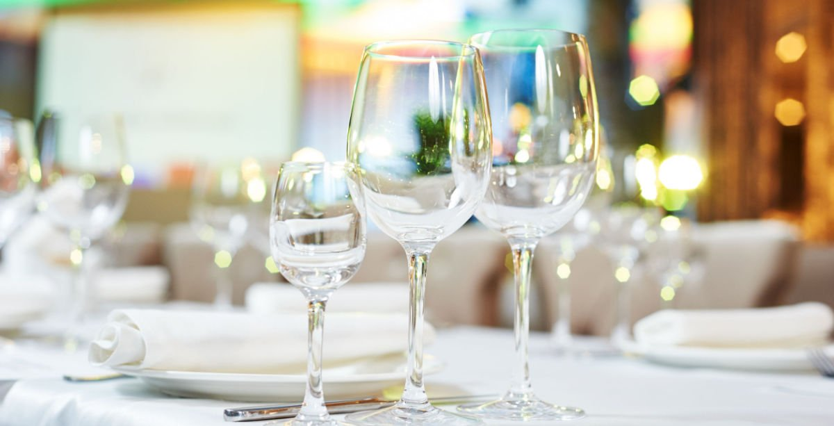 Wine glasses on table set for event
