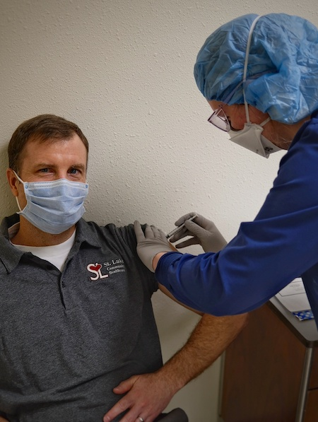 doctor receiving COVID 19 Vaccine