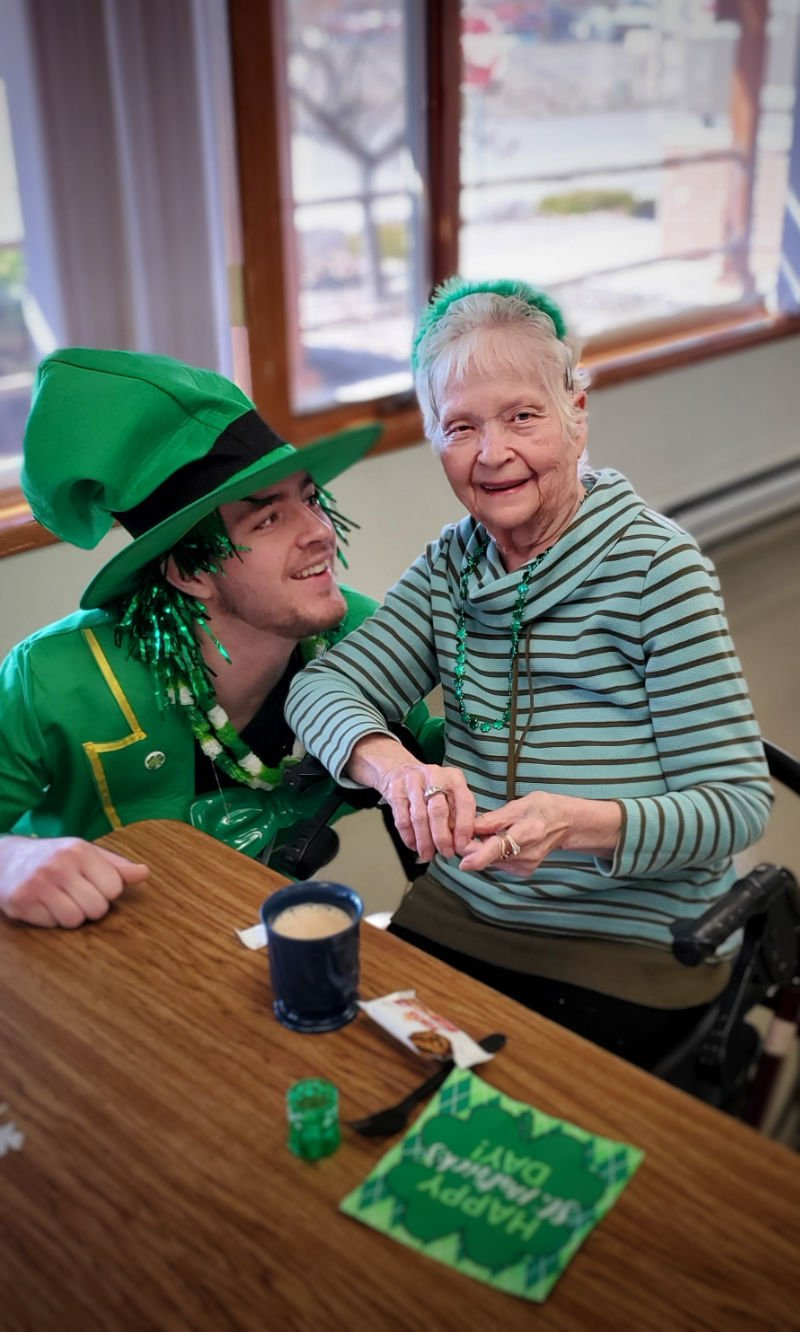 Employee with patient on St. Paddy's Day