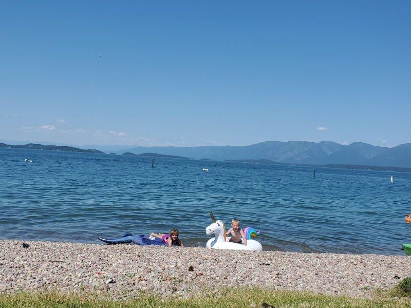 Kids playing on shoreline at Flathead Lake