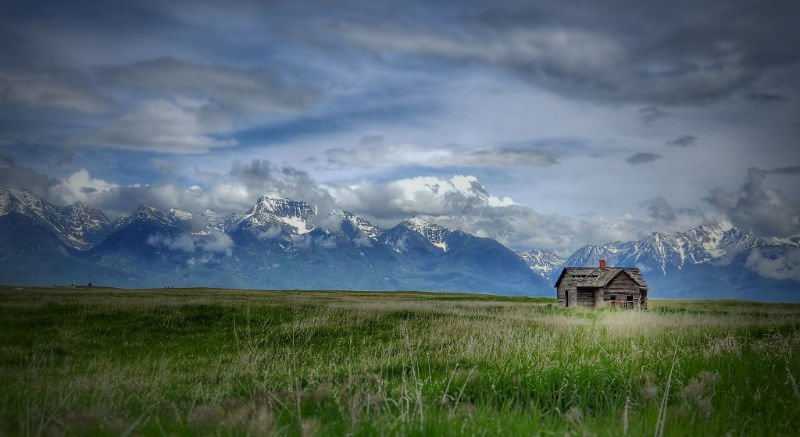 Mission Mountains with old tattered barn