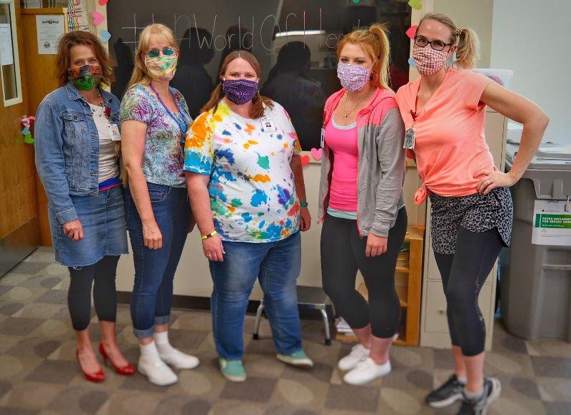 St Luke female staff members in masks