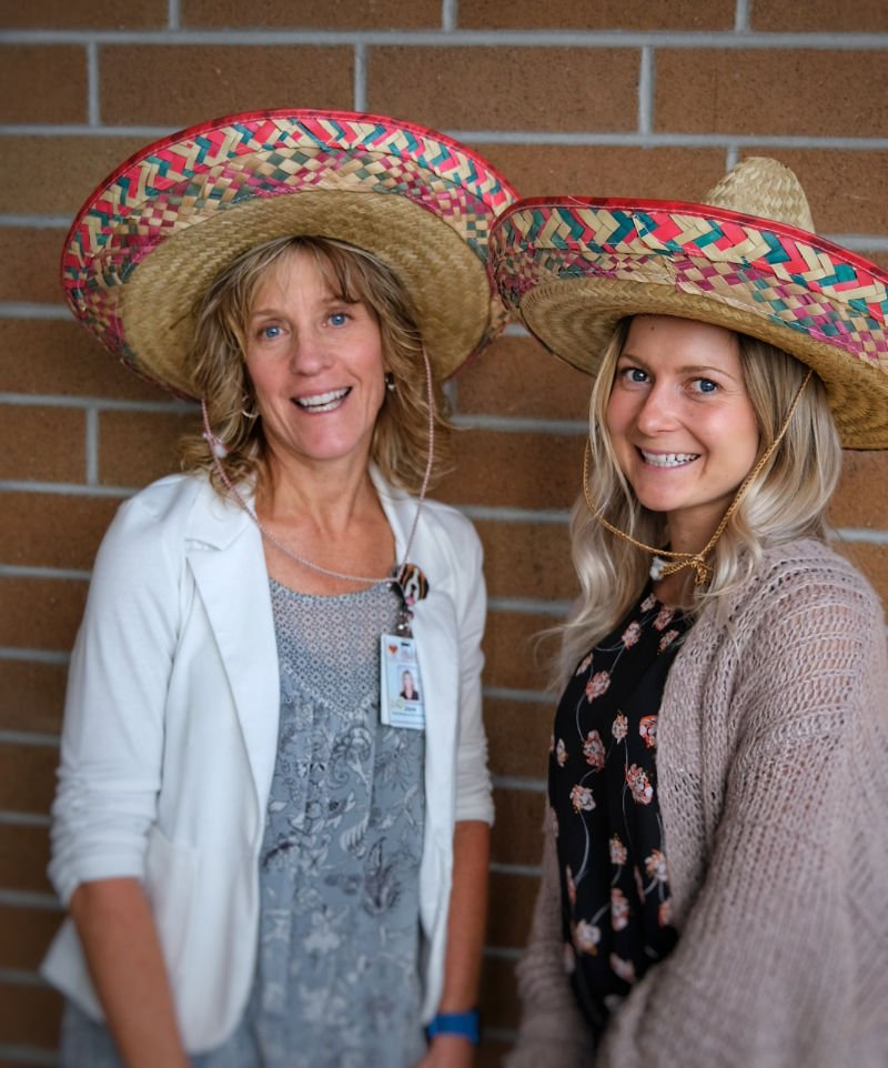 Two female employees in Sombreros