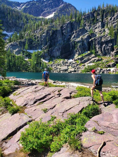 Two hikers in Glacier National Park